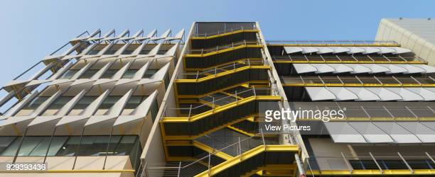 Exterior stairwell and sun shading. Siemens Masdar, Abu Dhabi, United Arab Emirates. Architect: Sheppard Robson, 2014.