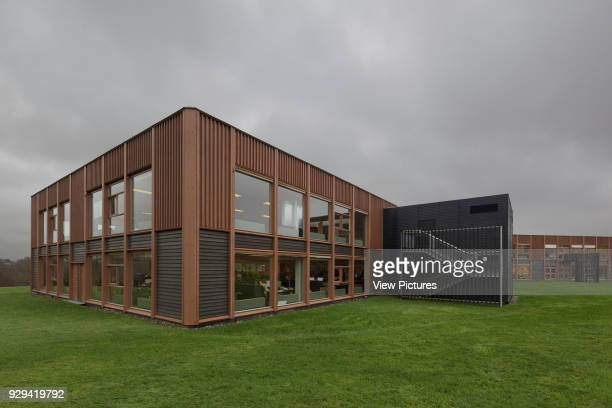 Exterior view against cloudy sky with Douglas fir external cladding IBC Innovation Factory Kolding Denmark Architect schmidt hammer lassen architects...