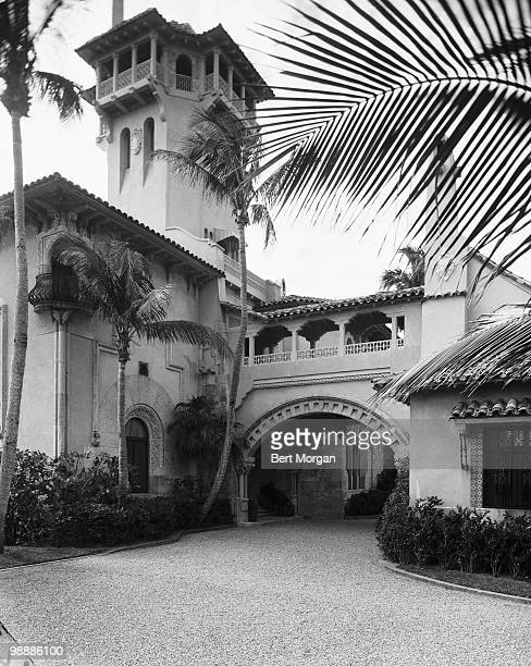 Exterior view along a driveway at the front of the portecochere at MaraLago Palm Beach Florida mid 1950s The residence designed by Marion Sims Wyeth...