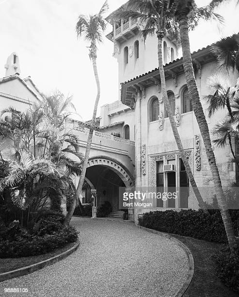 Exterior view along a driveway at the rear of the portecochere at MaraLago Palm Beach Florida mid 1950s The residence designed by Marion Sims Wyeth...