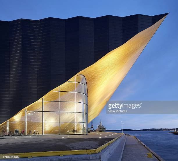 Exterior view at dusk showing overhang Kilden Performing Arts Centre Concert Hall Europe Norway ALA Architects