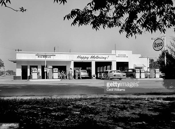 Exterior view from across the street of Sulton's Servicecenter and Esso gas station Orangeburg South Carolina 1958 One of few independently owned...