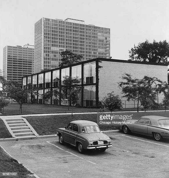 Exterior view from the parking lot of a two story building which is part of the Lafayette Park development in Detroit MI 1974 The complex which...