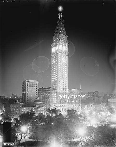Exterior view looking southeast across Madison Square Park at the Metropolitan Life Insurance Company Tower at night located on Madison Avenue and...