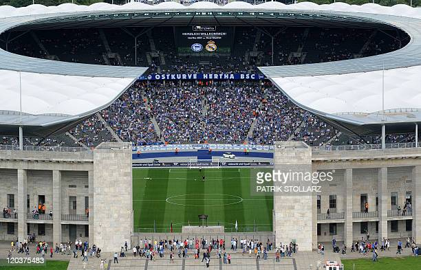 Exterior view of Berlin's Olympic stadium taken as supporters arrive to attend the friendly football match Hertha Berlin vs Real Madrid on July 27...