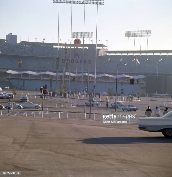 Exterior view of Dodger Stadium as seen across a mostly empty parking lot Los Angeles California August 1963