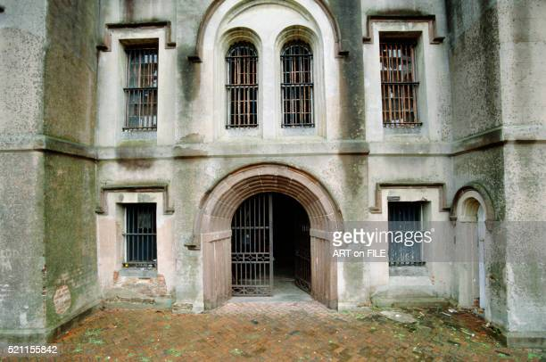 exterior view of entrance to old city jail in charleston, south carolina, installation site of untitled by antony gormley - antony gormley stock pictures, royalty-free photos & images