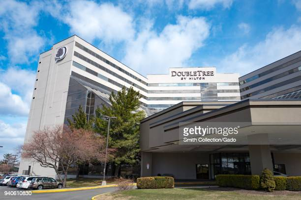 Exterior view of facade of the Doubletree Newark Airport hotel by Hilton Hotels in Newark New Jersey on a sunny day March 16 2018