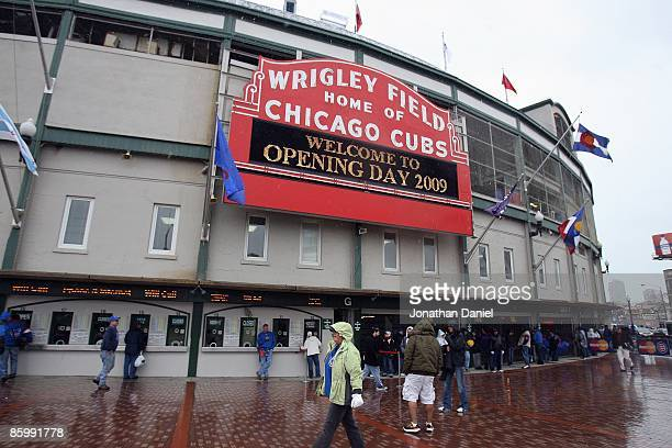 Exterior view of fans arriving in the rain for the Opening Day game between the Chicago Cubs and the Colorado Rockies on April 13 2009 at Wrigley...