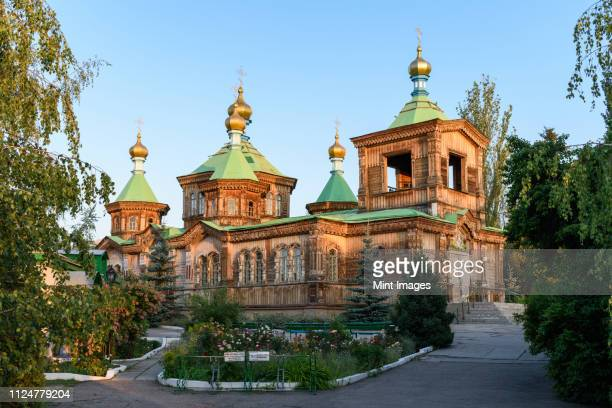 exterior view of holy trinity cathedral, karakol, kyrgyzstan. - kyrgyzstan stock pictures, royalty-free photos & images