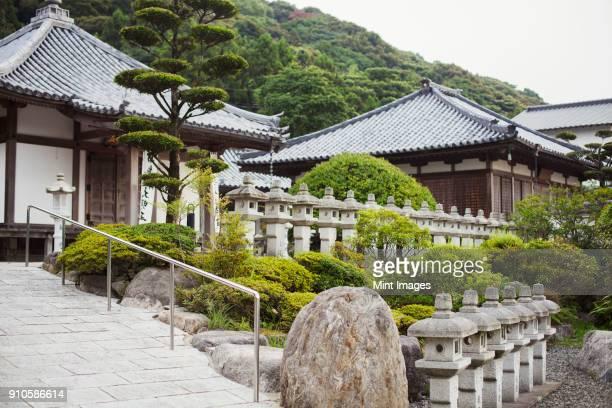 exterior view of japanese buddhist temple. - shingon buddhismus stock-fotos und bilder