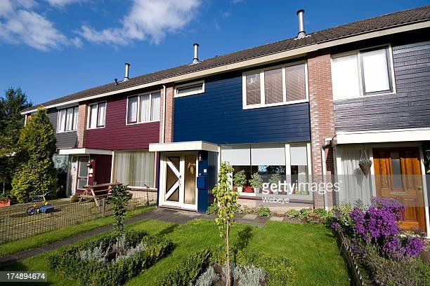 Exterior view of multicolored Dutch homes connected together