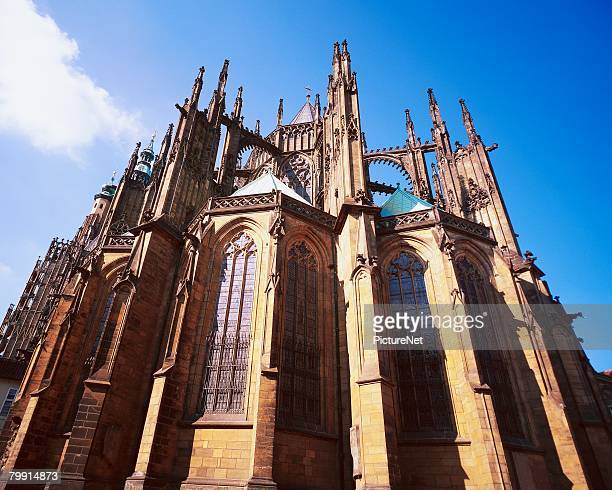 exterior view of st. vitus cathedral - flying buttress stock photos and pictures