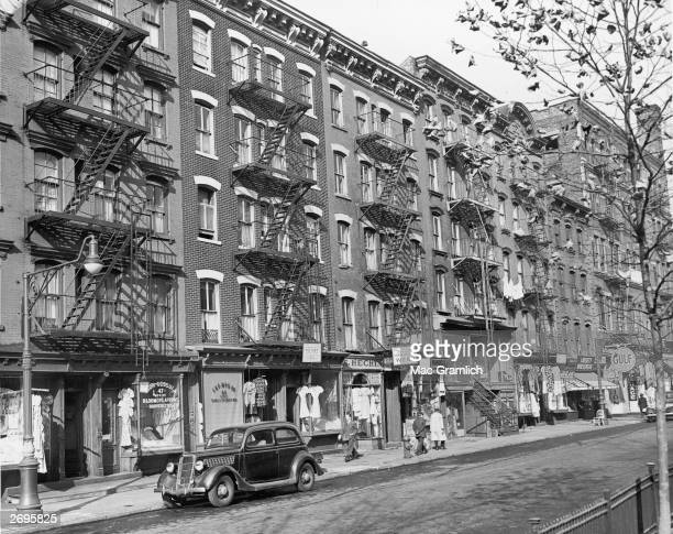 Exterior view of storefronts in tenement buildings on the Lower East Side of Manhattan New York City