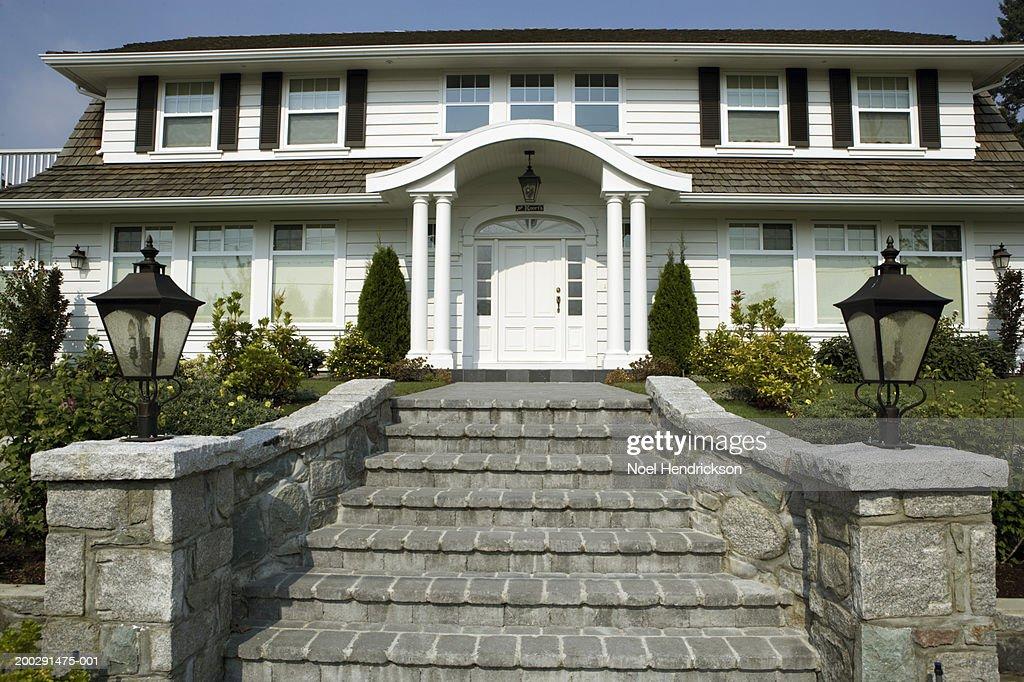 Exterior View Of Suburban House Stone Steps Leading To Front Door