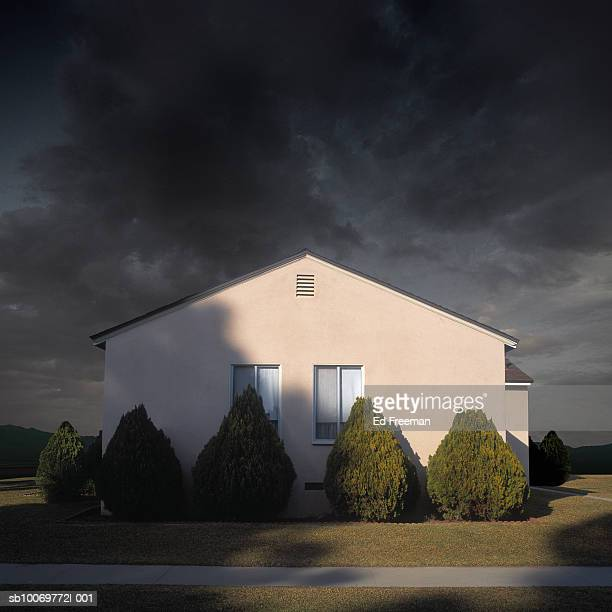 exterior view of suburban house under stormy sky, close-up - twilight stock pictures, royalty-free photos & images