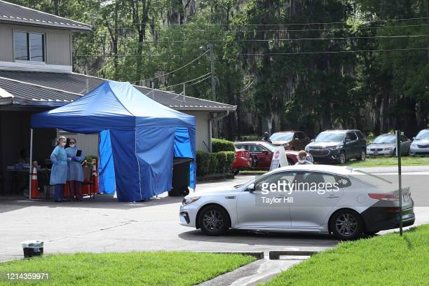 Exterior view of the Baptist Health Coronavirus Care Clinic on March 23, 2020 in Montgomery, Alabama. Medical staff are administering tests in...