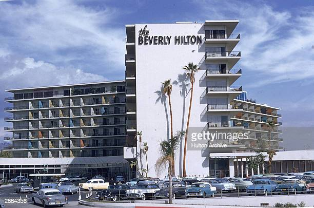 Exterior view of the Beverly Hills Hilton with cars parked in front, California. Circa 1950s.