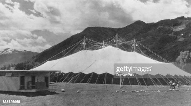 Exterior view of the big orange and white tent under which all cultural activites of the Goethe Biccentennial festival will take place Tent designed...