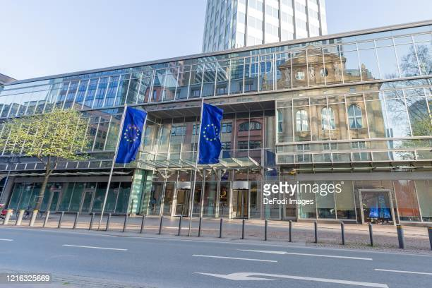 Exterior view of the entrance area of ??the European Central Bank with European flags on March 27, 2020 in Frankfurt am Main, Germany.
