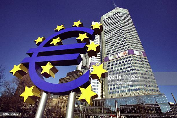 Exterior view of the European Central Bank in Frankfurt, in the foreground the Euro logo with stars.