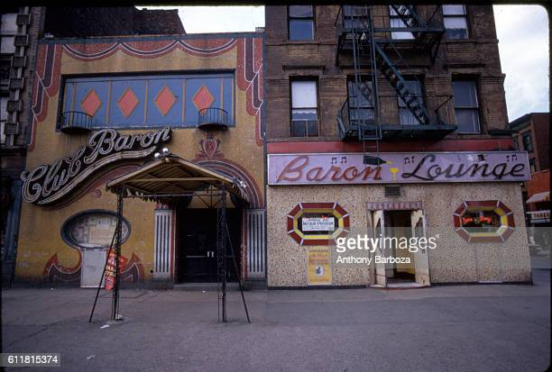 Exterior view of the exterior the Club Baron and Baron Lounge Jazz club in Harlem New York New York 1970s