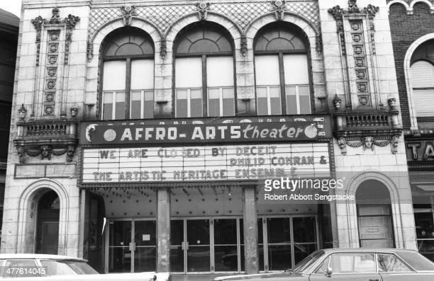 Exterior view of the facade and marquee of the Affro-Arts Theater , Chicago, Illinois, 1968. The marquee reads 'We Are Closed By Deceit' & 'Philip...