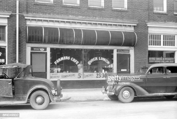 Exterior view of the 'Farmers Cafe' Durham North Carolina 1940 Signs offer 'Hot Weiners Hamburgers for 5 ' The restaurant has two entrances one...