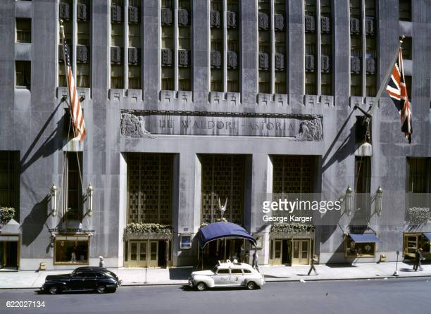 Exterior view of the front entrance of the Waldorf Astoria Hotel, New York, New York, 1941.