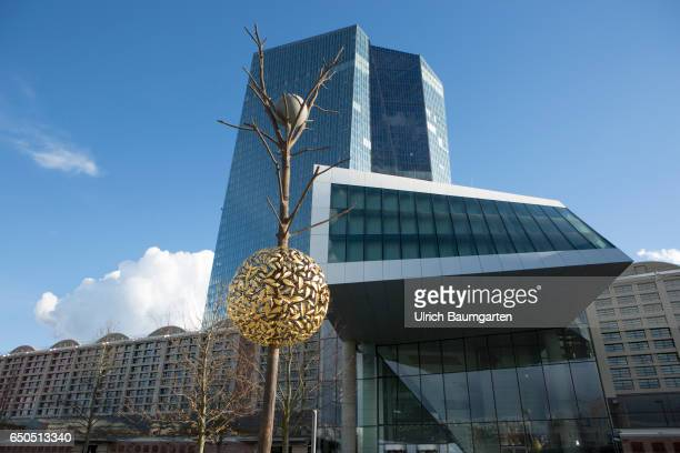 Exterior view of the headquarters of the European Central Bank in Frankfurt In the foreground Gravity and Growth from Guiseppe Penone