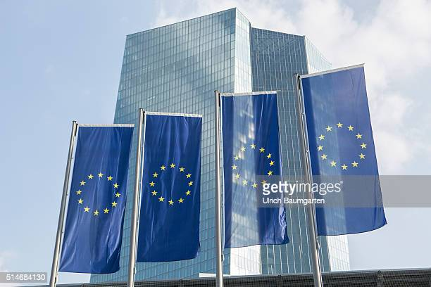 Exterior view of the headquarters of the European Central Bank with flags of the European Union