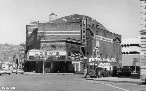 Exterior view of the Loew's Sheridan Theatre New York New York March 7 1969 The marquee advertises 'Guess Who's Comign to Dinner' and 'To Sir With...