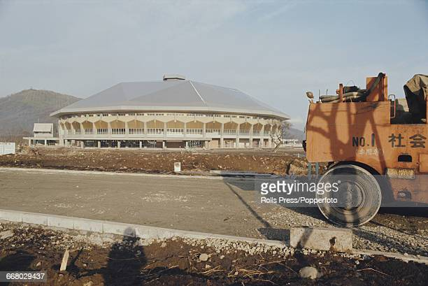Exterior view of the Makomanai Ice Arena in Makomanai Park Sapporo Japan under construction in December 1970 prior to hosting the ice hockey and...