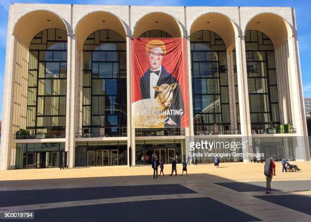 Exterior view of the Metropolitan Opera House from Lincoln Center Plaza New York New York October 22 2017 A large banner advertises the premiere of...