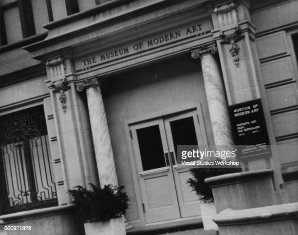Exterior view of the Museum of Modern Art New York New York 1920s or 1930s A sign in front advertises an exhibition of 'Fantastic Art Dada and...