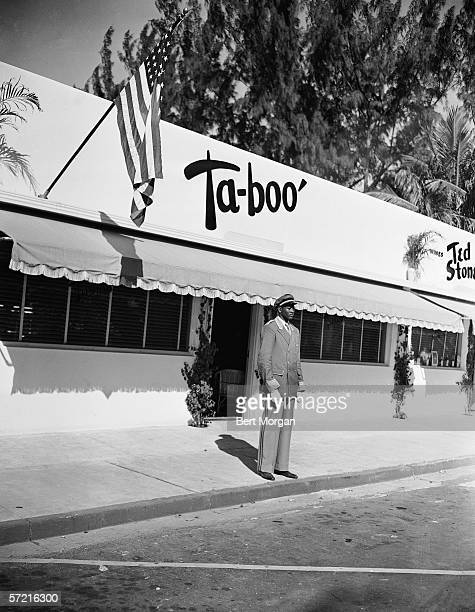 Exterior view of the night club 'Taboo' shows doorman on duty Worth Avenue Palm Beach Florida 1942