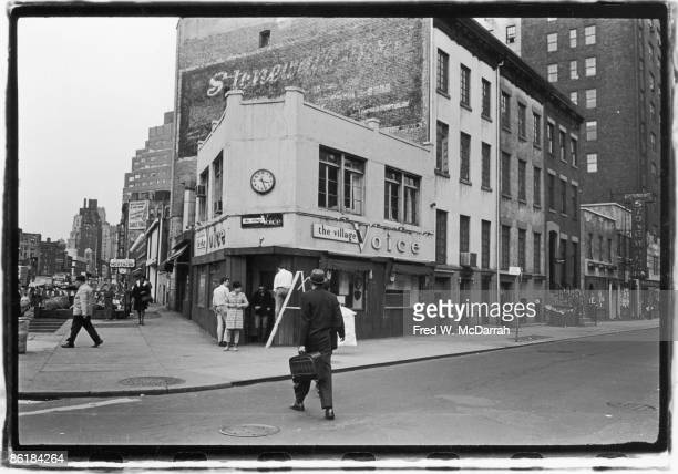 Exterior view of the offices of the Village Voice newspaper on Sheridan Square New York New York May 1 1966 The painted billboard above advertises...
