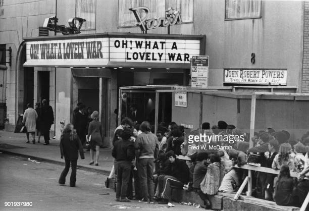 Exterior view of the Paris Theater where a large crowd waits queues a screening of 'Oh What a Lovely War' New York New York October 15 1969