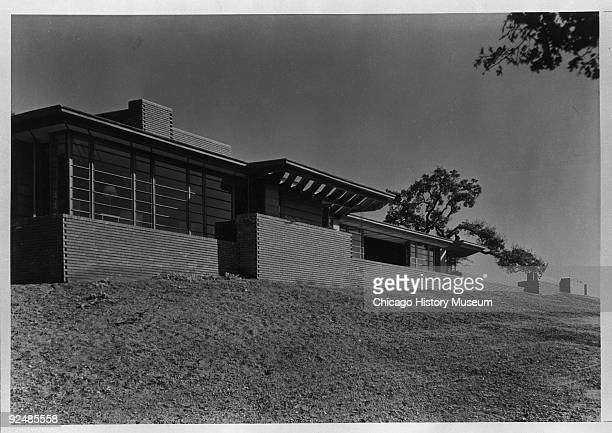 """Exterior view of the Paul R. Hanna residence at 737 Frenchman's Road in Palo Alto , known as the """"Honeycomb House"""", designed by Frank Lloyd Wright,..."""