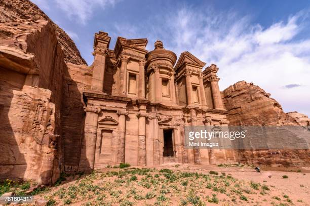 Exterior view of the rock-cut architecture of El Deir or The Monastery at Petra, Jordan.