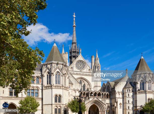 LONDON March 2019 Exterior view of the Royal Courts of Justice building on the Strand in London with the royal coat of arms and signage The Royal...
