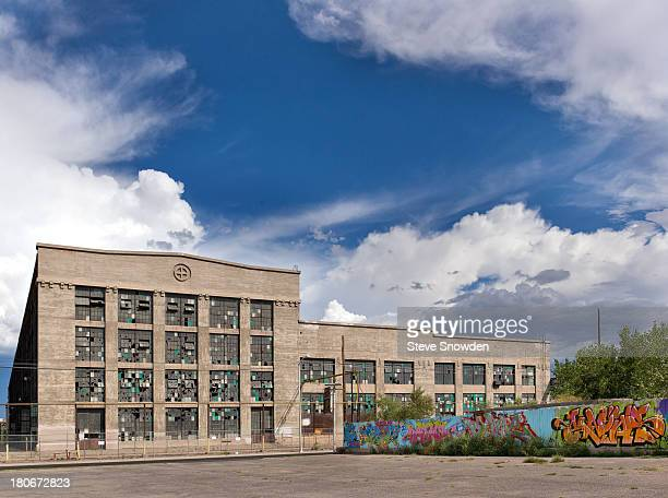 A exterior view of the Santa Fe Railroad Centralized Work Equipment Shop on September 01 2013 in Albuquerque New Mexico This abandoned facility and...