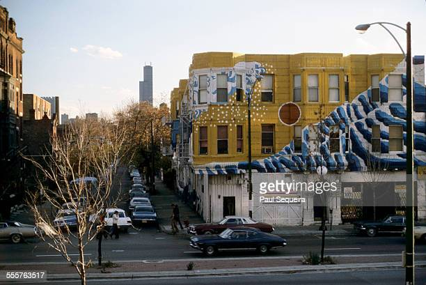 Exterior view of the Wieland Center building with Sachio Yamashita's wave mural on the corner of North Avenue and Wieland Street Chicago Illinois...