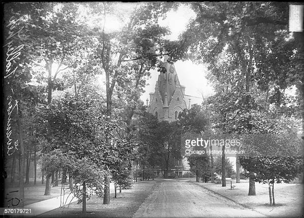 Exterior view of University Hall at Northwestern University looking down a path leading toward the building Evanston Illinois 1900s This image was...