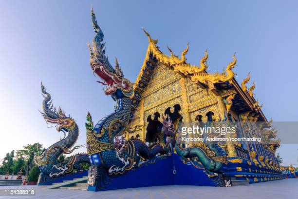 exterior view of wat rong suea ten (blue temple) in chiang rai, thailand, southeast asia, asia - wat stock pictures, royalty-free photos & images