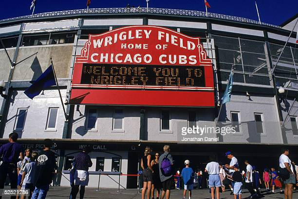 Exterior view of Wrigley Field as fans stream into the ballpark for the Chicago Cubs home game with Florida Marlins at Wrigley Field on August 22,...