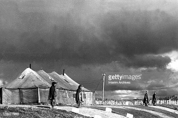 Exterior view showing soldiers guarding the site of the military armistice negotiations between representatives of the Communist forces and United...