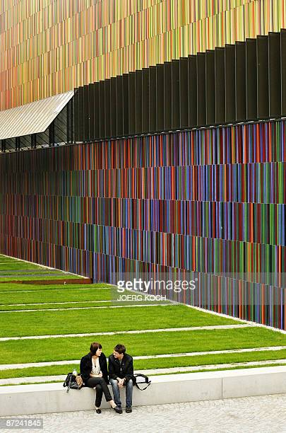 Exterior view taken on May 14 2009 shows people sitting outside the Museum Brandhorst in the southern German city of Munich that is set to open to...