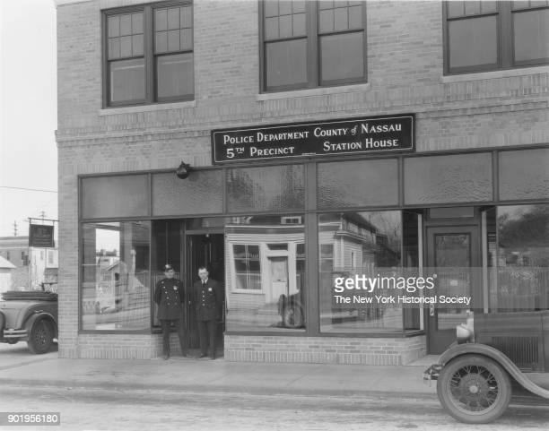 Exterior view with officers in doorway of Valley Stream Police Station 5th Precinct Nassau County New York 1929