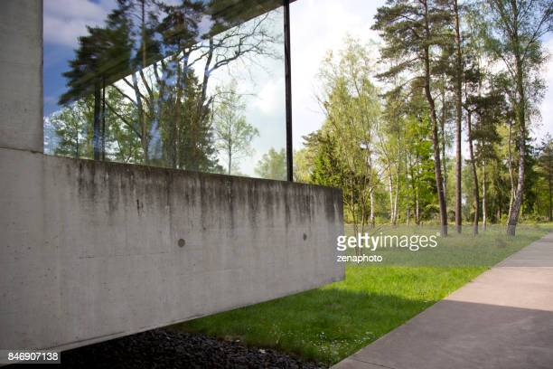 exterior visitors center bergen-belsen camp - celle stock photos and pictures